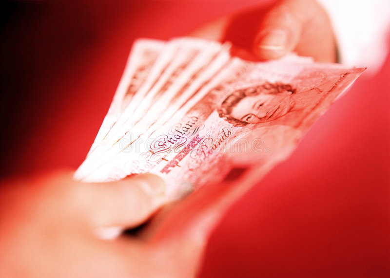 English money. Changing hands in financial transaction royalty free stock photography