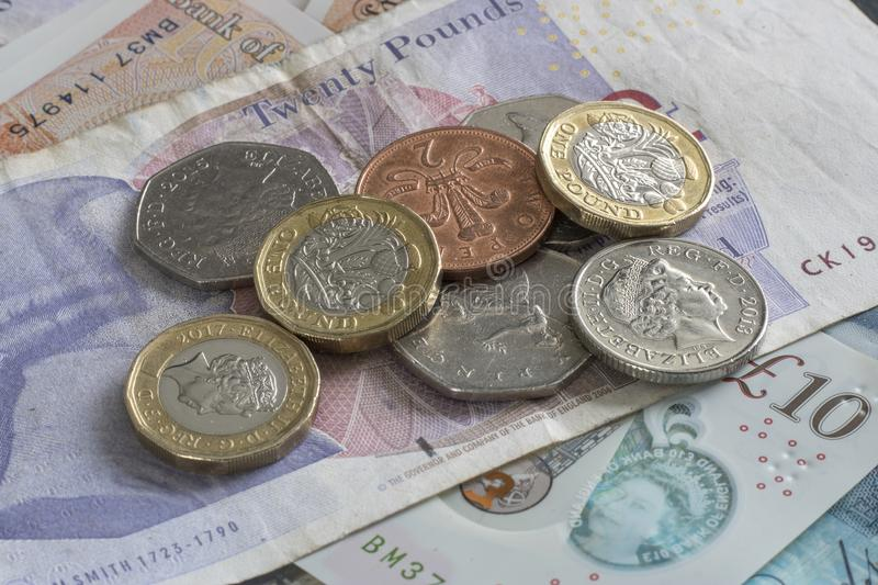 English money notes and change. English money in change and notes layed out on a table royalty free stock photography