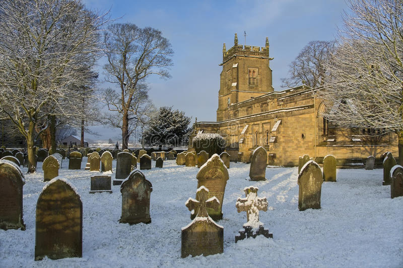 English Parish Church - North Yorkshire - England. Winter snow in the graveyard of an English Parish Church in the small village of Slingsby in North Yorkshire royalty free stock photos