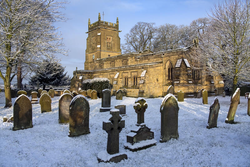 English Parish Church - North Yorkshire - England. Winter snow in the graveyard of an English Parish Church in the small village of Slingsby in North Yorkshire stock images