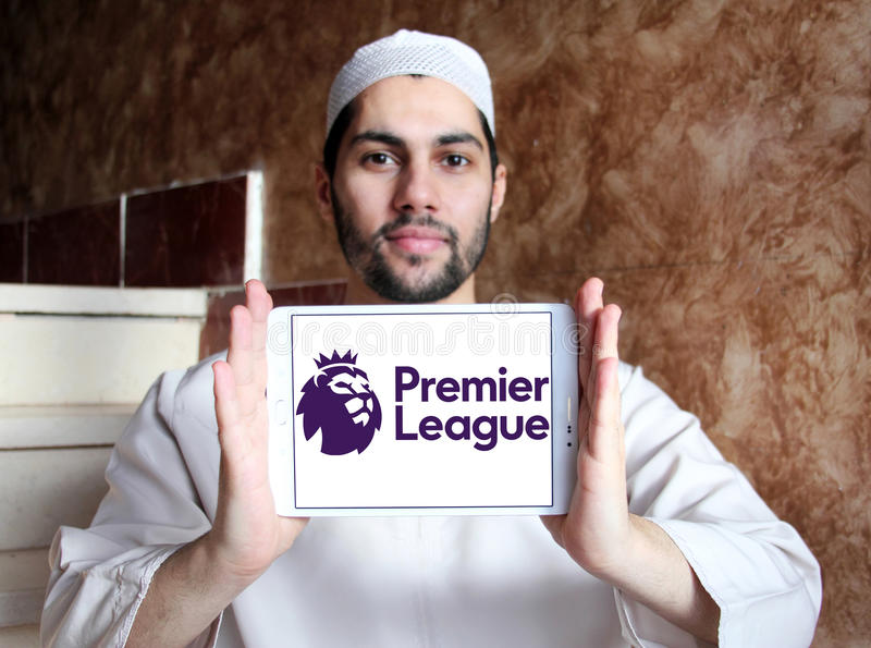 English premier league logo. Logo of english premier league on samsung tablet holded by arab muslim man stock photography