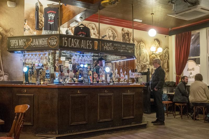English Pub in Leeds. Leeds, England - October 25, 2018: Interior of the popular music pub Duck & Drake in the Kirkgate area of Leeds. Leeds is the largest town stock image