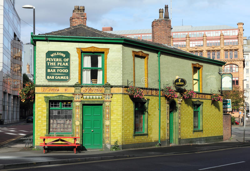 English Pub. Peveril of The Peak, a Popular Victorian tile clad English public house in Manchester, England stock image