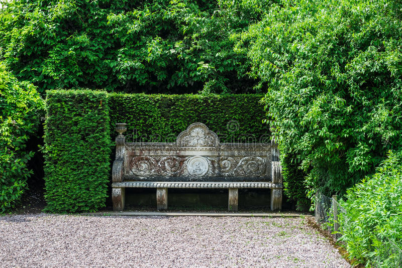 English Public Garden in Summer. Old Stone Bench in the Beautiful English Public Garden in Summer, England, UK royalty free stock images