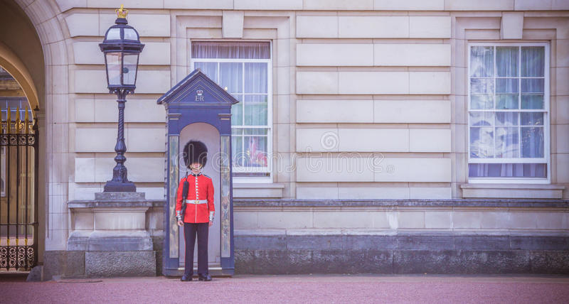 English Queen s Guard, London. An English soldier of the Queen's guard at Buckingham Palace, London, England, United Kingdom royalty free stock photo