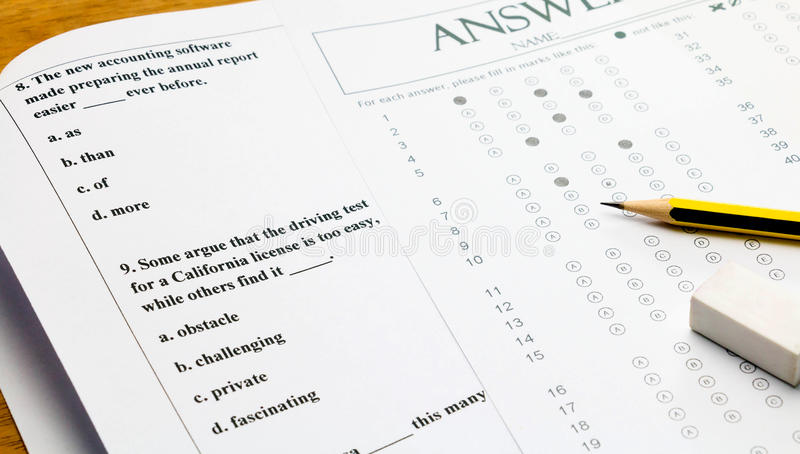 English question and answer sheet on table. Closeup english multiple choice question and answer sheet with pencil for english test royalty free stock photography