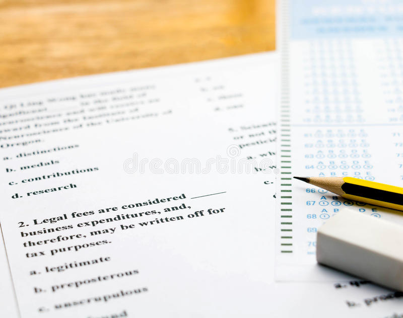 English question and answer sheet on table. Closeup english multiple choice question and answer sheet with pencil for english test stock images