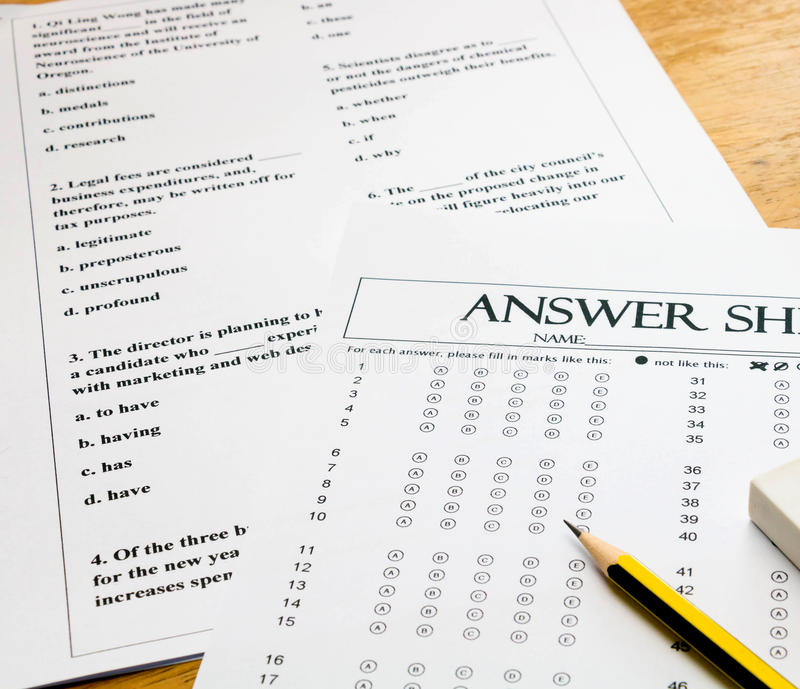 English question and answer sheet on table. Multiple choice english question sheet and answer sheet with pencil for english test royalty free stock image