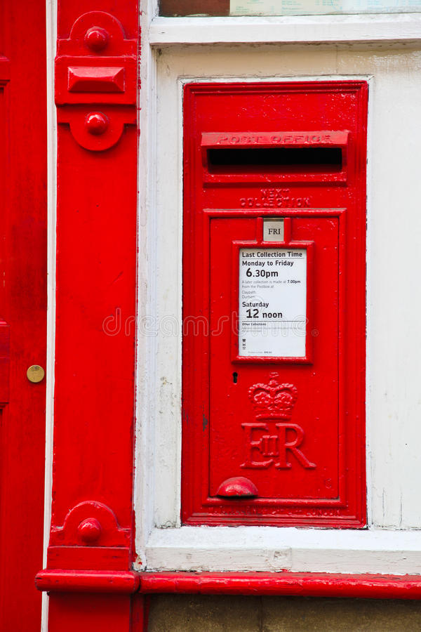 English Red Letter Box next to a red door stock photos