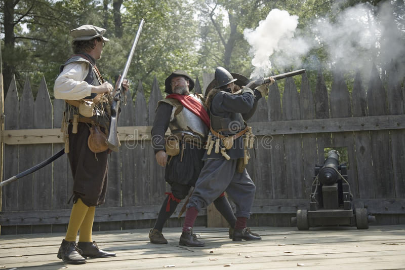English reenactor soldiers. Firing guns at James Fort, Jamestown Settlement, on the 400th Anniversary of Jamestown, Virginia, May 4, 2007 royalty free stock photography