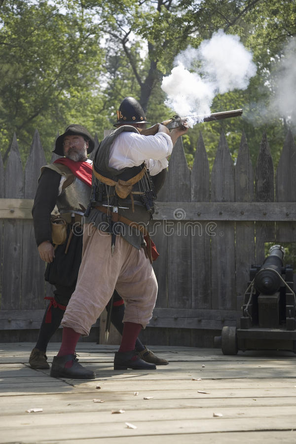 English reenactor soldiers firing guns. At James Fort, Jamestown Settlement, on the 400th Anniversary of Jamestown, Virginia, May 4, 2007 royalty free stock photo