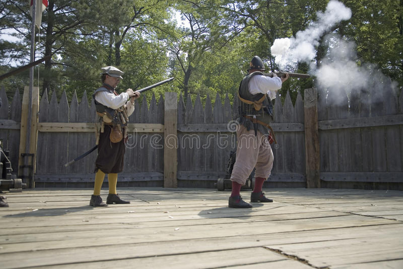 English reenactor soldiers firing guns. At James Fort, Jamestown Settlement, on the 400th Anniversary of Jamestown, Virginia, May 4, 2007 royalty free stock image