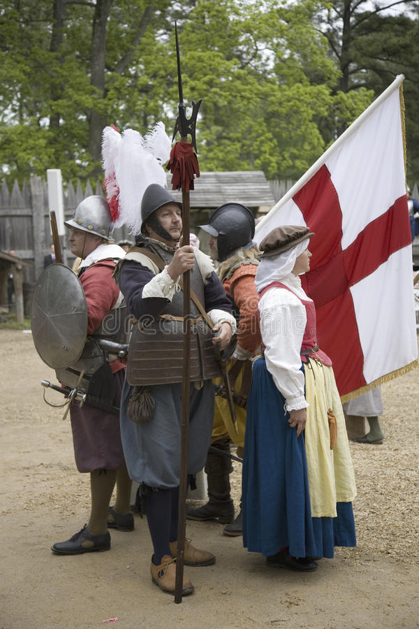 English settler reenactors. Holding English flag bearing the Cross of St. George as part of the 400th anniversary of the Jamestown Colony, Virginia, attended by stock photos