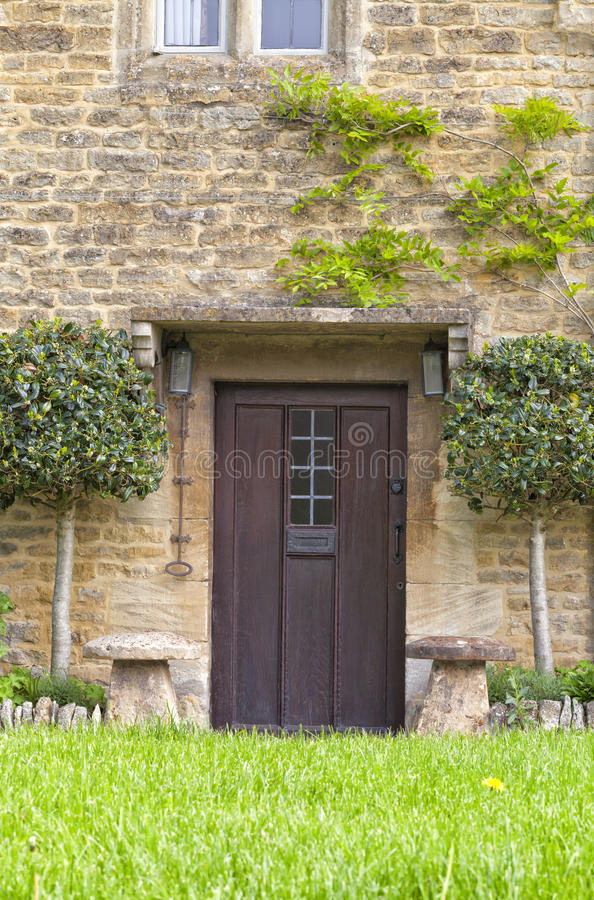 English Stone Cottage With Brown Wood Doors Stock Photo Image Of