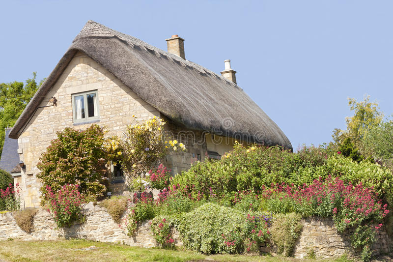 Download English Stone Cottage With Colourful Summer Garden Stock Image