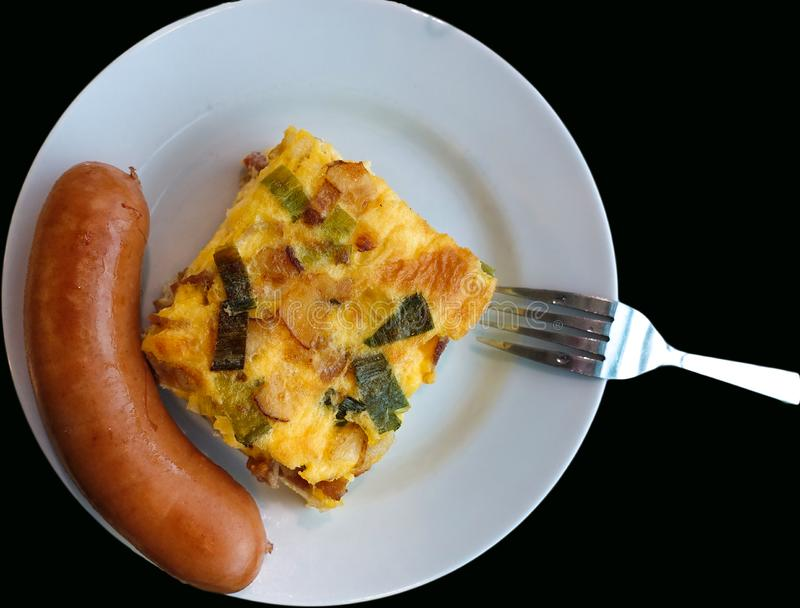 English style breakfast. Sausage, omelet isolated on a black background royalty free stock images