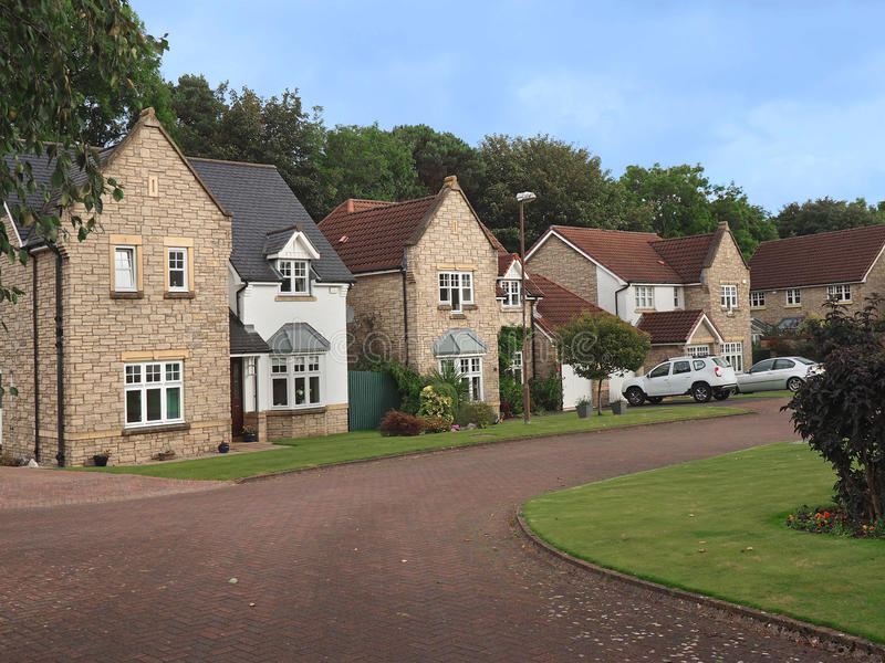 English suburban street. With well maintained middle class stone houses with gables royalty free stock photos