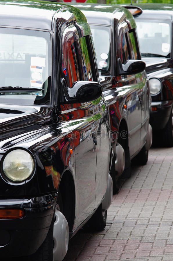 English Taxis Lined Up On Stock Photo