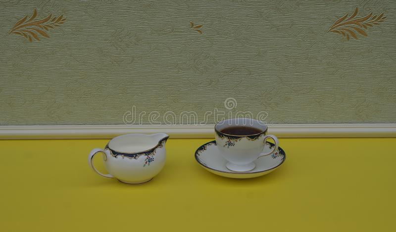 English teacup with saucer and cream jug, fine bone china porcelain stock photo
