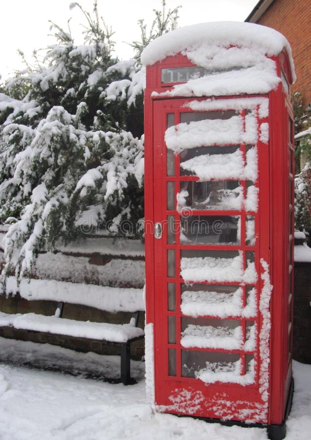 English telephone box on the snow royalty free stock photos