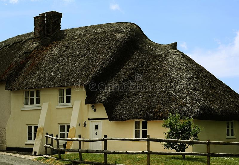 English Thatched Cottage. Thatched English Countryside Cottage, set against summer sky royalty free stock images