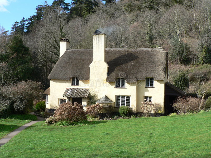 English Thatched Cottage. Picture taken in the beautiful village of Selworthy in Somerset royalty free stock photography