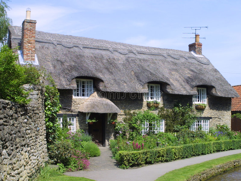English thatched cottage. At Thornton Dale, Yorkshire, England, UK royalty free stock photos