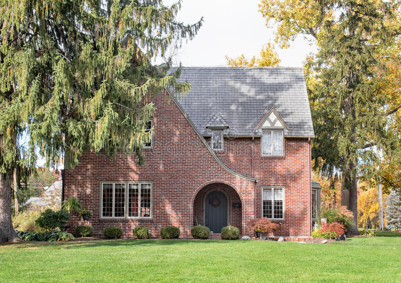 English Tudor Home with Pine Trees royalty free stock photo