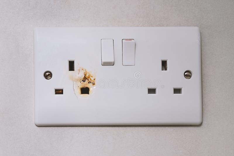 Broken power overload switch electric outlet stock photography