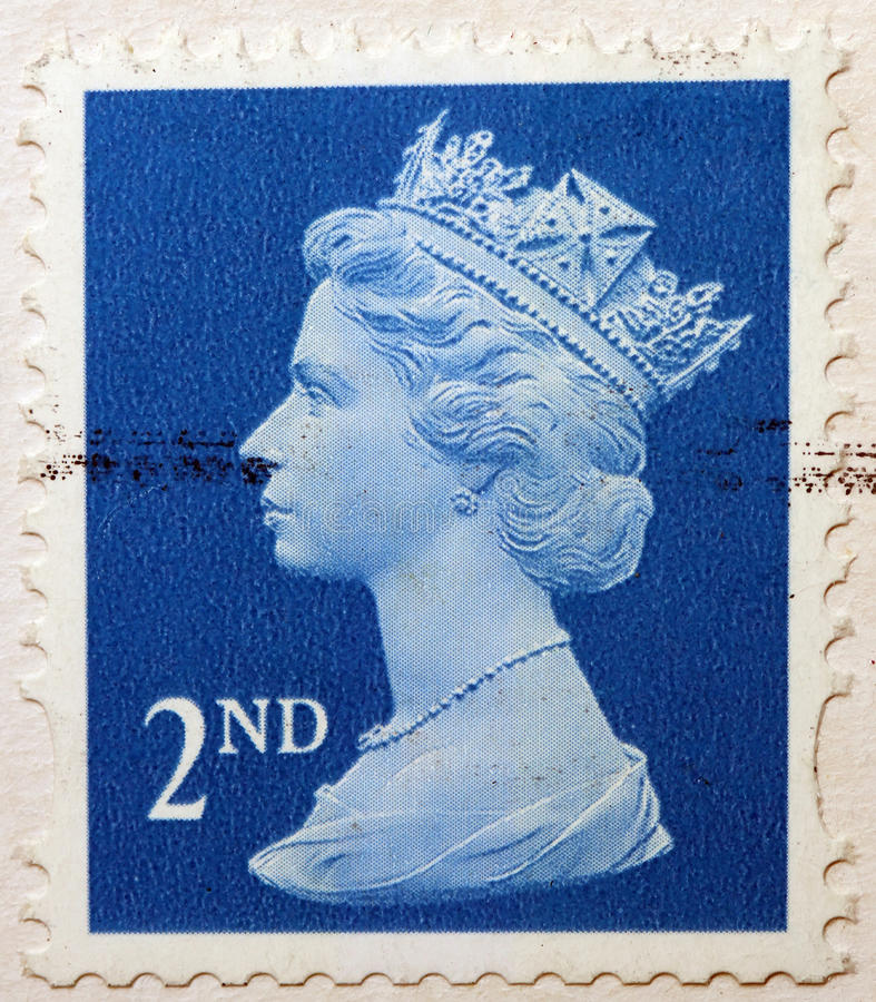 English Used Second Class Postage Stamp showing Portrait of Queen Elizabeth 2nd. Circa 2010 stock image