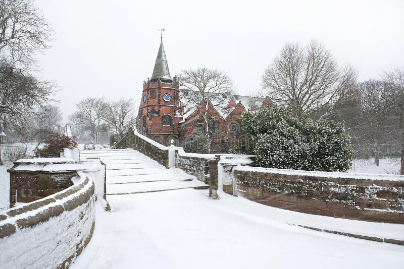 English village bridge in winter snow. royalty free stock photos