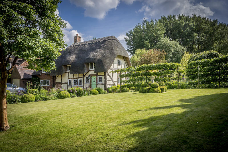 English Village Thatched Cottage and garden. Picturesque English thathced cottage and garden stock images