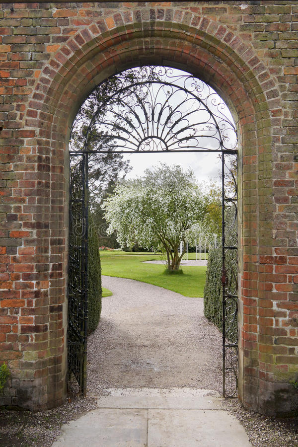 An English walled garden with arch royalty free stock photos