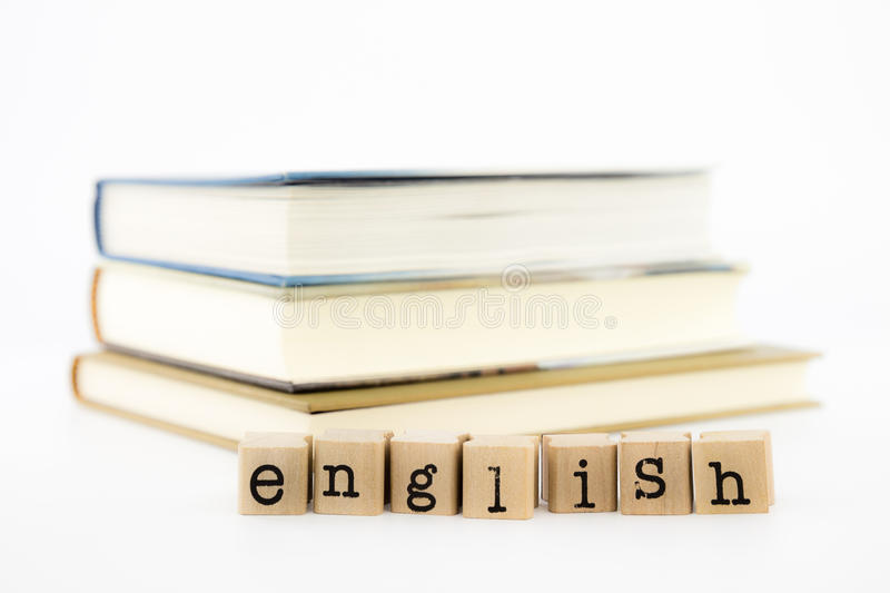English wording stack on books stock photography