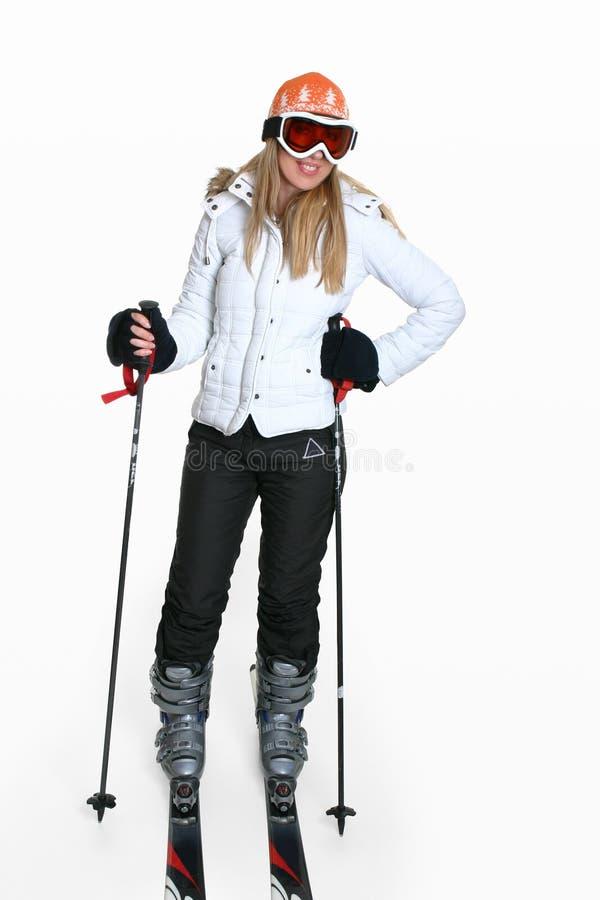Engranaje femenino del esquí que desgasta foto de archivo