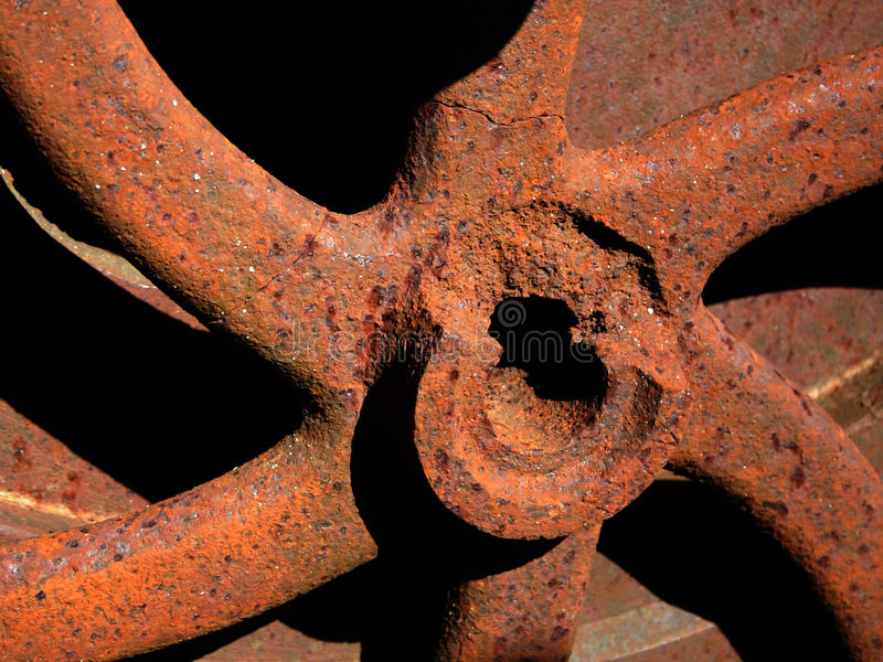 Engranaje oxidado viejo. Detalle. imagen de archivo