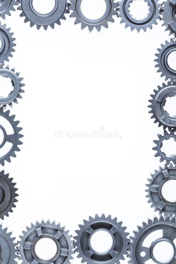 Engranajes de metales pesados que forman una frontera imagen de archivo libre de regalías