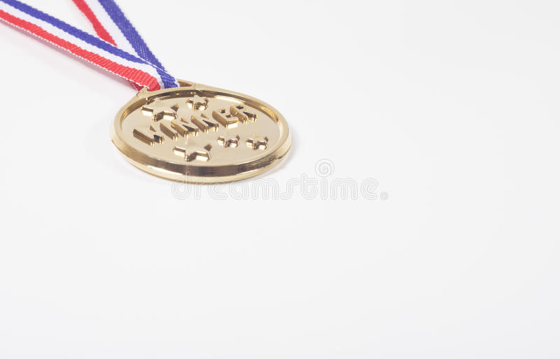 Engraved gold medal for a winner of a competition stock photo