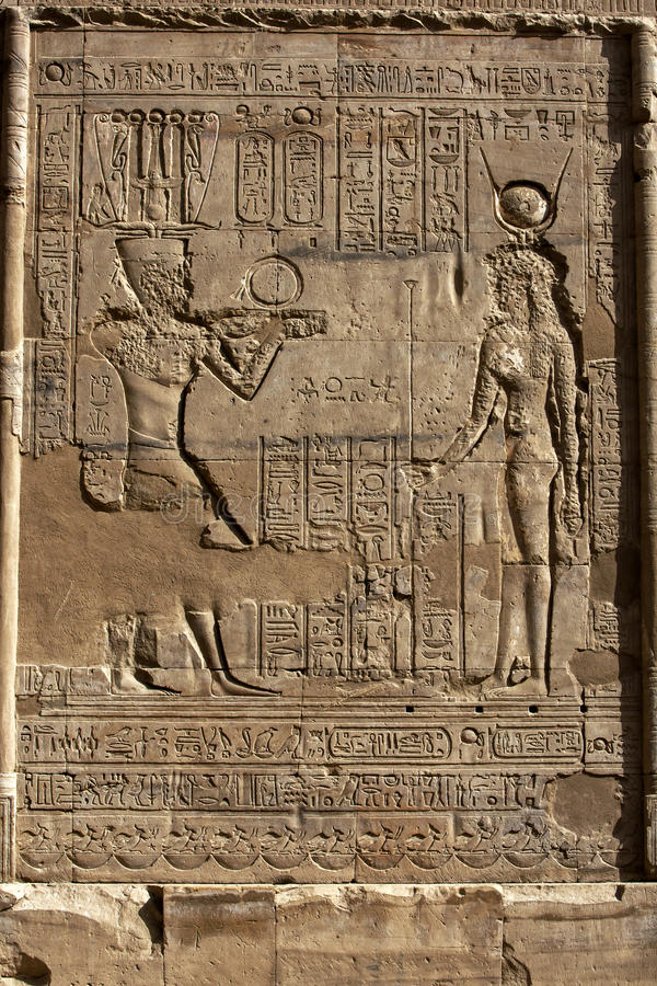 Engraved reliefs and hieroglyphs at the Temple of Horus at Edfu in Egypt. stock images