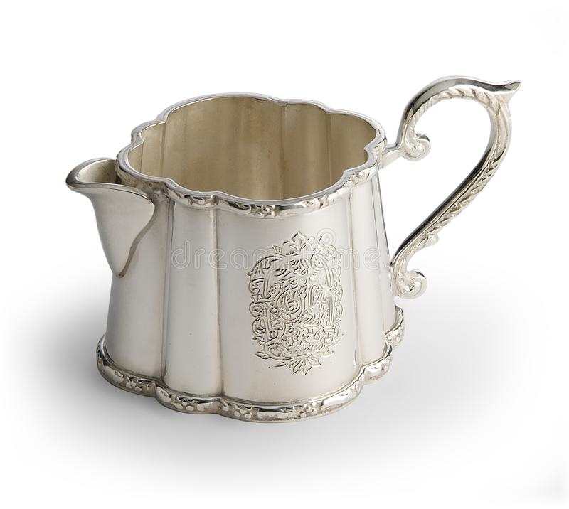 Engraved silver milk jug stock photo