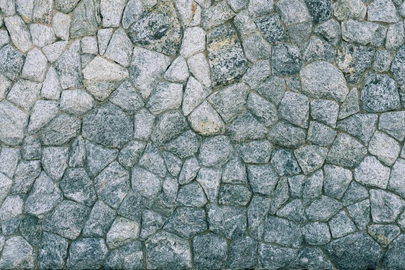 Engraved stone brick wall texture pattern background. Copy space, rock, pixel, wallpaper, backdrop, hard, heavy, solid, square, abstract, empty, blank, frame stock images