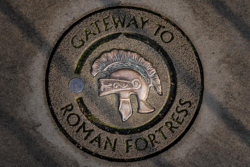 Engraved stone of Gateway to Roman Fortress in York with a roman soldier helmet.  stock images