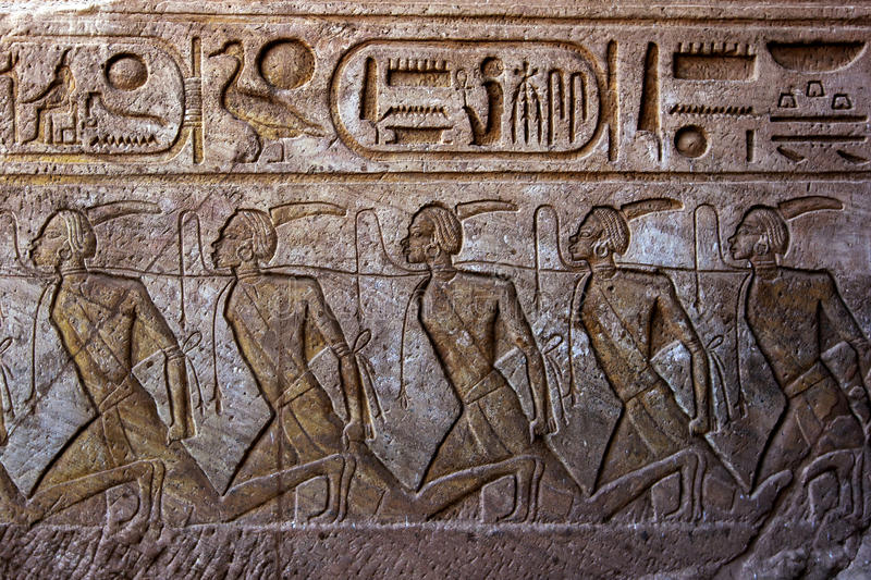 A engraving on the wall leading into the Great Temple of Ramses II at Abu Simbel in Egypt. stock photos