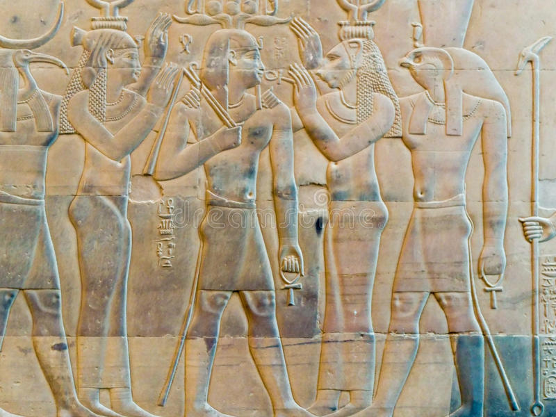Engravings on the wall of the ancient temple of Egypt. stock photos
