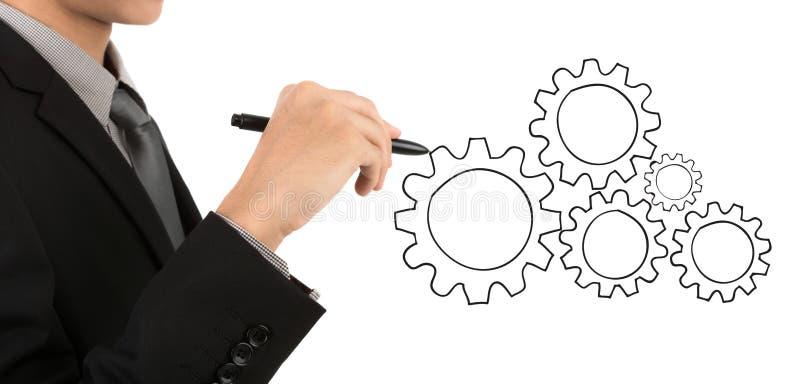 Engrenagem do desenho da mão do homem de negócios ao conceito do sucesso foto de stock royalty free