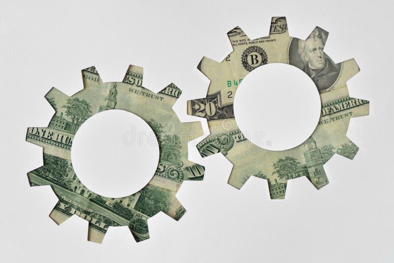 Engrenagem feita de cédulas do dólar - conceito de sistema financeiro fotos de stock