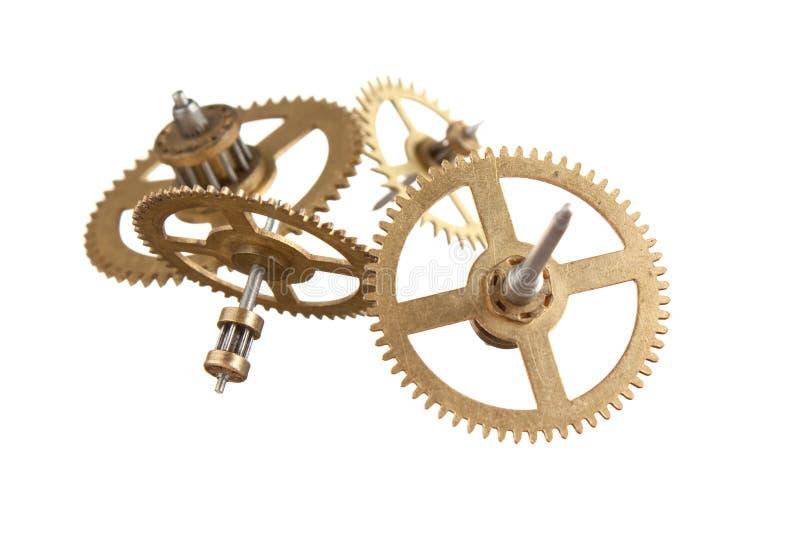 engrenagens do maquinismo de relojoaria isoladas imagens de stock