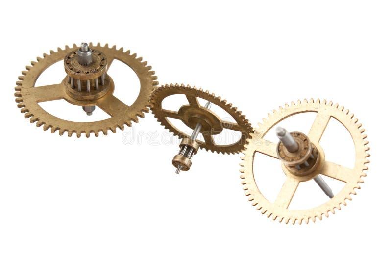 engrenagens do maquinismo de relojoaria isoladas fotografia de stock