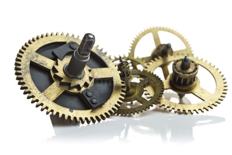 Engrenagens do maquinismo de relojoaria no branco imagens de stock