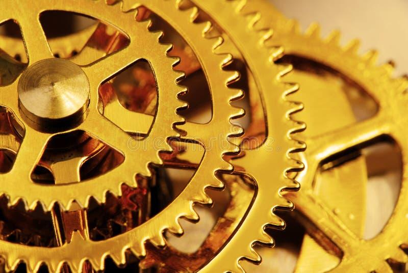 Engrenagens douradas imagens de stock